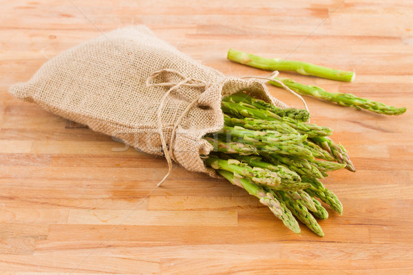 green asparagus pouch  on table Stock photo © neirfy