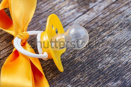 baby pacifier on wooden table Stock photo © neirfy