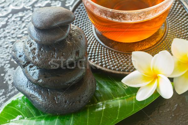 Preto zen pedras molhado flores verde Foto stock © neirfy