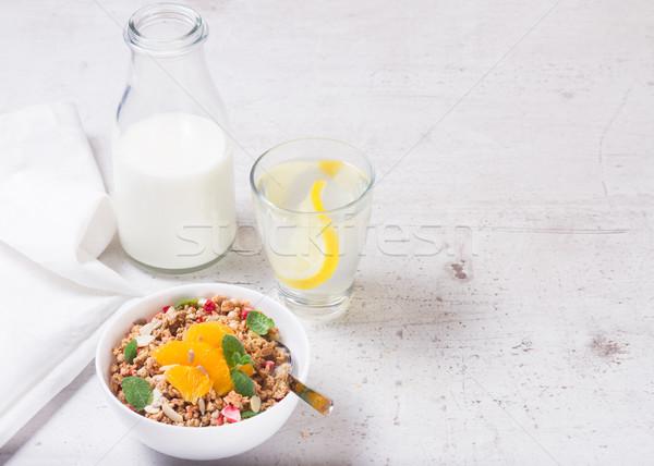 Egészséges reggeli granola tányér narancs szeletek Stock fotó © neirfy
