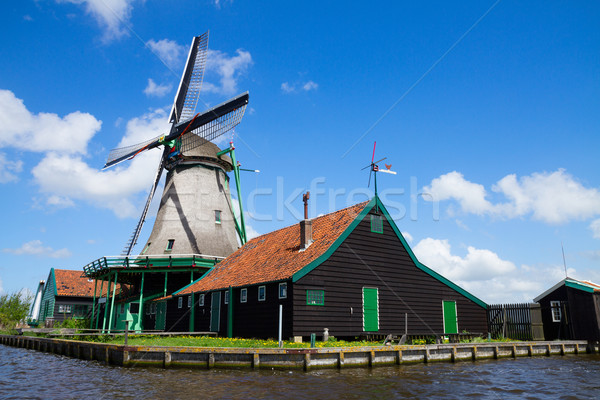 old dutch windmill over  river waters Stock photo © neirfy