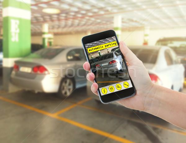 Automatique parking main téléphone voiture Photo stock © neirfy