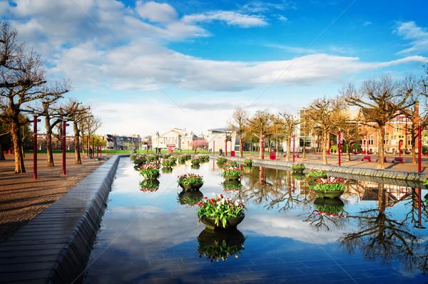Praça Amsterdam tulipas Holanda retro edifício Foto stock © neirfy