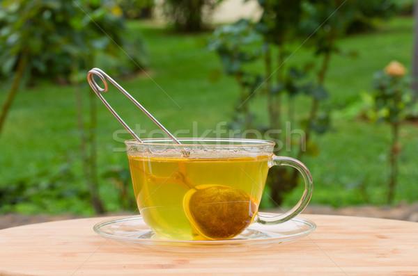 Kubek herbaty zielone ogród piłka muzyka Zdjęcia stock © neirfy