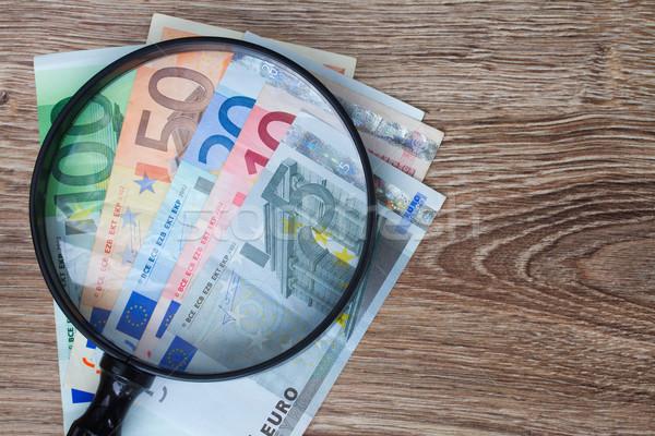 Euro guardando vetro finanziare Foto d'archivio © neirfy