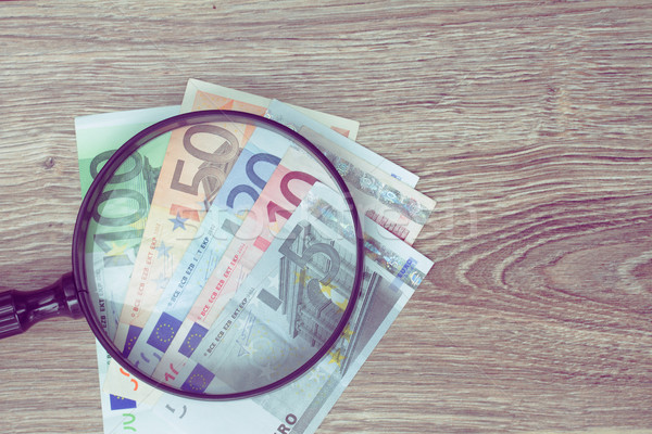 euro banknotes under looking glass Stock photo © neirfy