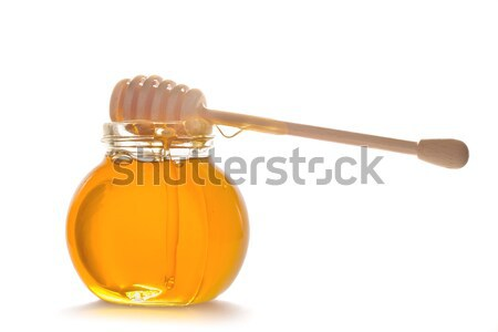honey in glass pot with stick Stock photo © neirfy