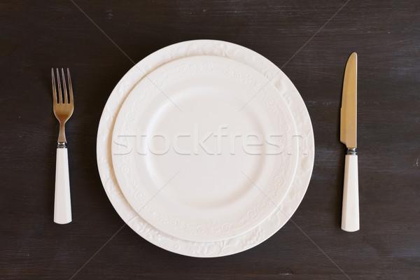 Tafelgerei ingesteld tabel platen donkere houten Stockfoto © neirfy