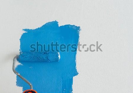 Alguém pintura parede branco azul cor Foto stock © neirfy
