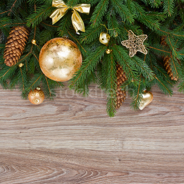Arany díszítések zöld fenyőfa keret díszített Stock fotó © neirfy