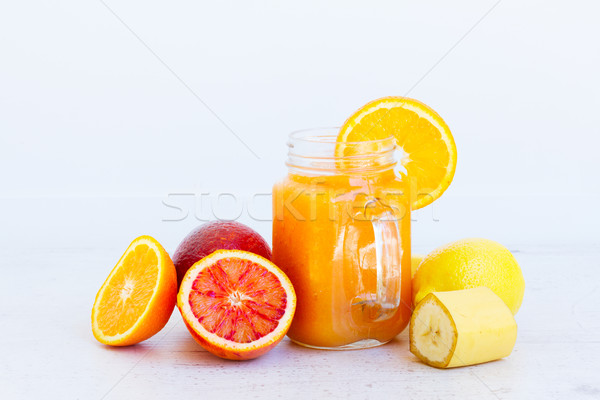 Fresh smoothy orange drink Stock photo © neirfy
