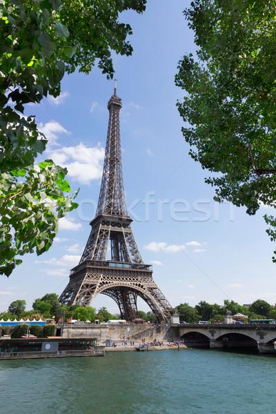 Eiffel turné folyó fa zöld levelek Párizs Stock fotó © neirfy