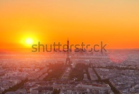 Torre Eiffel Parigi cityscape sopra arancione tramonto Foto d'archivio © neirfy