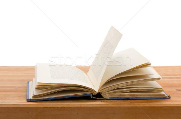 Nyitott könyv egy fa asztal izolált fehér iskola Stock fotó © neirfy