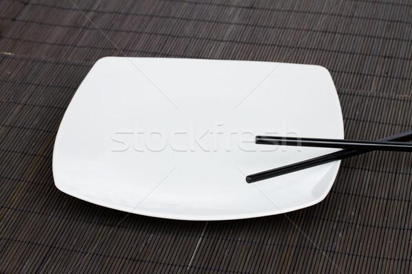 Piatto vuota bianco bacchette alimentare Foto d'archivio © neirfy