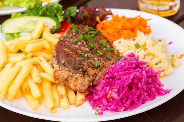 Plaque viande steak garnir frites françaises dîner Photo stock © neirfy