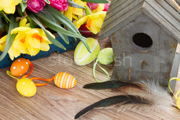 birdcage with tulips and daffodils Stock photo © neirfy