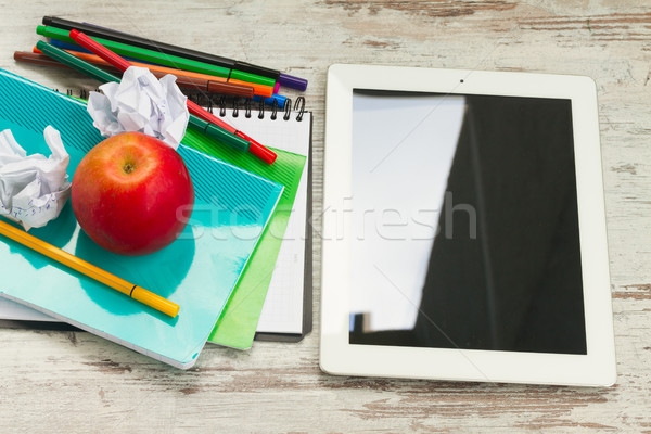 Apple with school supplies Stock photo © neirfy