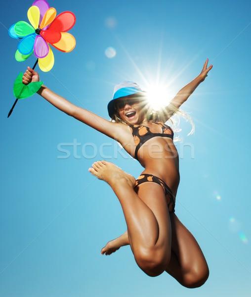 Heureux petite fille sautant fleur enfant amusement Photo stock © Nejron
