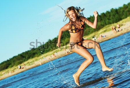 Stock photo: Pin up girl in the swimming pool