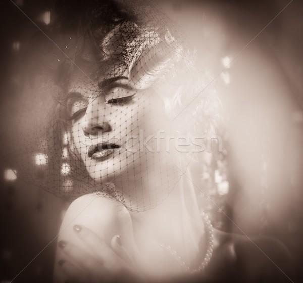 Toned portrait of elegant blond retro woman with beautiful hairdo wearing veil Stock photo © Nejron
