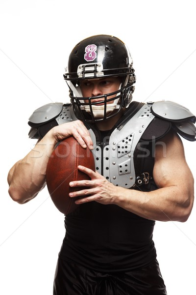 American football player with ball wearing helmet and protective shields  Stock photo © Nejron