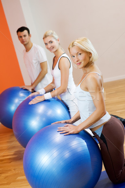Group of people doing fitness exercise with a bal Stock photo © Nejron