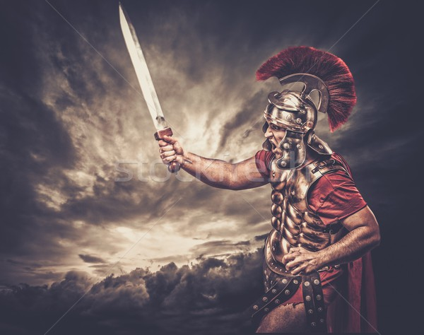Legionary soldier against stormy sky Stock photo © Nejron