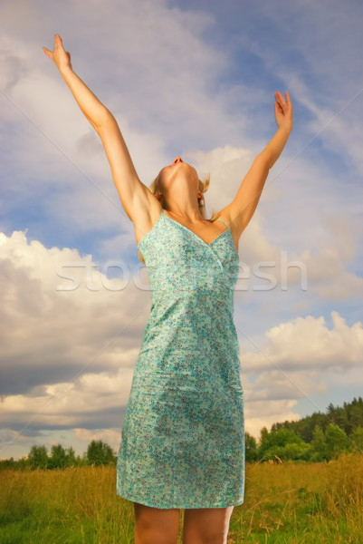 красивая девушка области синий облачный небе за Сток-фото © Nejron