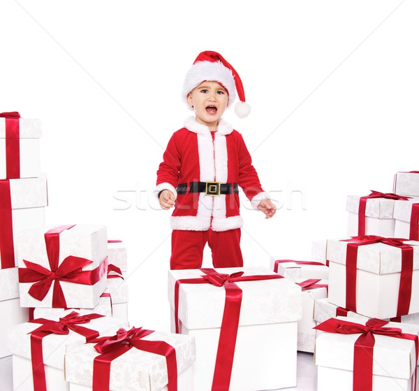 Displeased baby boy in Santa Claus costume  Stock photo © Nejron
