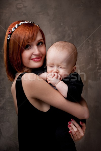 Beautiful redhead woman with her child. Stock photo © Nejron