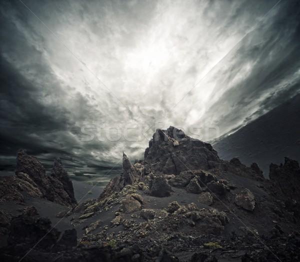 Dramatic sky over rocks. Stock photo © Nejron