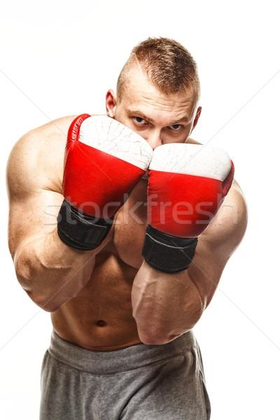 Guapo muscular joven guantes de boxeo mano Foto stock © Nejron