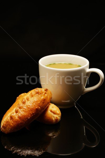Hot bullion in cup with tasty tarts  Stock photo © Nejron