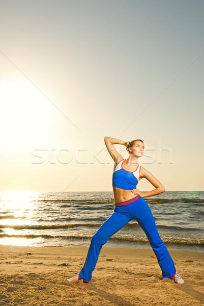 Сток-фото: красивой · фитнес · осуществлять · пляж · закат