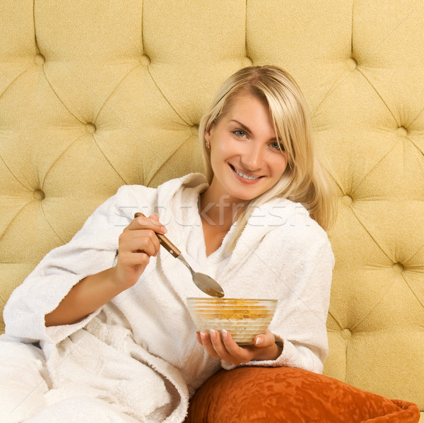 Beautiful young woman has breakfast in bed Stock photo © Nejron