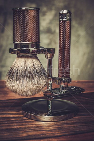 Safety razor and shaving brush on a stand  Stock photo © Nejron