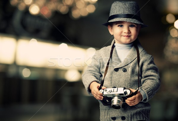 Baby boy with retro camera over blurred background. Stock photo © Nejron