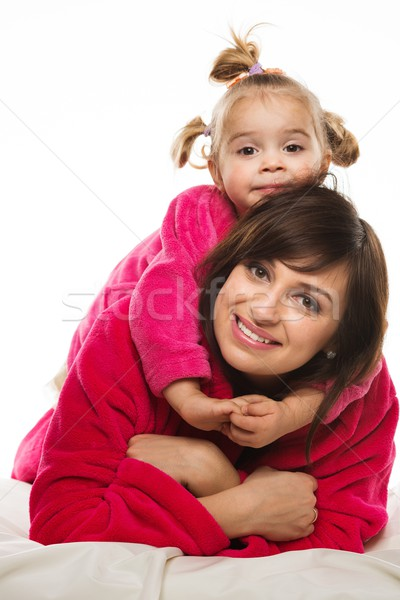 Happy mother and daughter in dressing gowns  Stock photo © Nejron