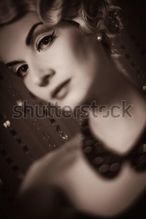 Toned picture of elegant blond retro woman  with beautiful hairdo  Stock photo © Nejron