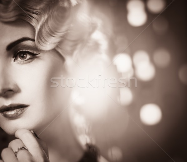 Toned portrait of elegant blond retro woman  with beautiful hairdo  Stock photo © Nejron