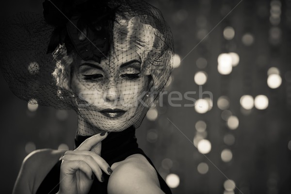 Monochrome picture of  elegant blond retro woman   wearing little hat with veil  Stock photo © Nejron