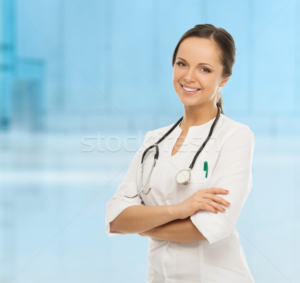 Young positive doctor woman in hospital hallway  Stock photo © Nejron