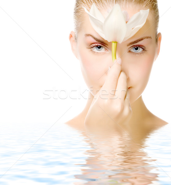 Beautiful woman with lily flower reflected in water Stock photo © Nejron