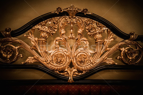Back of expensive bed with golden ornament Stock photo © Nejron