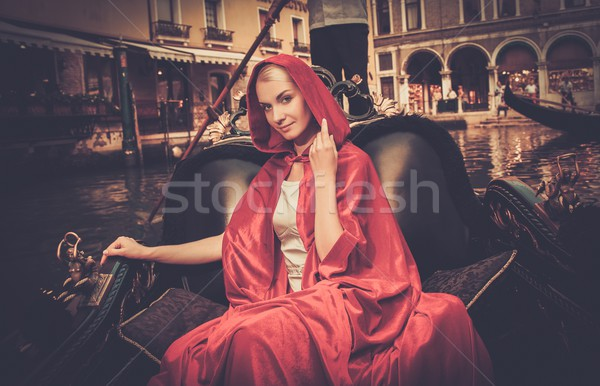 Beautiful woman in red cloak riding on gondola Stock photo © Nejron