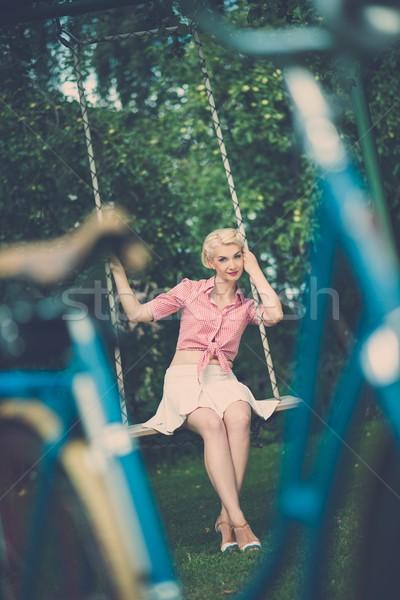 Stock fotó: Gyönyörű · szőke · retro · nő · ül · szabadtér