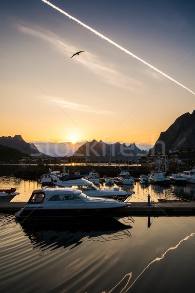 Yachts and boats near moorage at sunset in Reine village, Norway Stock photo © Nejron