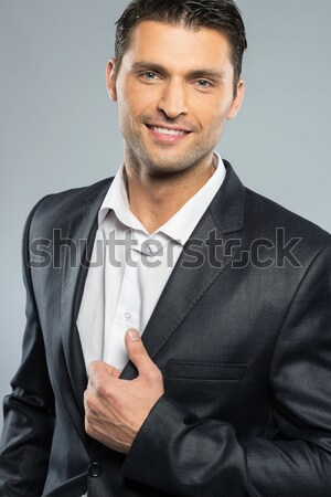 Knap jonge man zwart pak witte shirt geïsoleerd Stockfoto © Nejron
