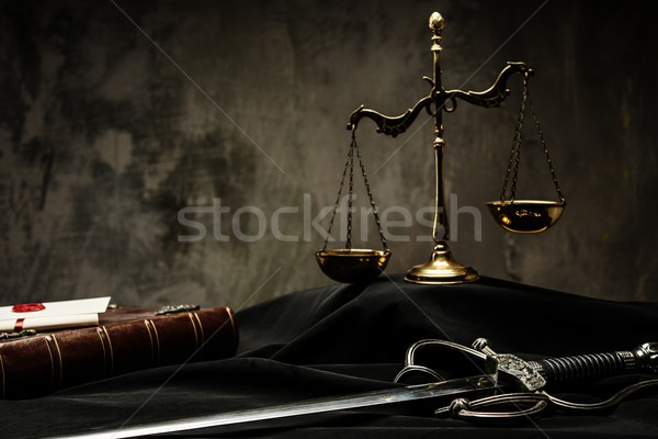 Scales, book and Sword of Justice on a judge's mantle Stock photo © Nejron